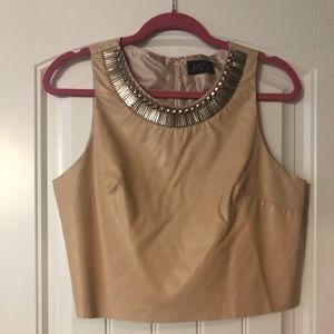 Faux leather crop top with embellishment